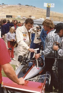 Werner Erhard and his Formula V racecar at Laguna Seca Raceway in June 1979 during the Breakthrough Racing experiment