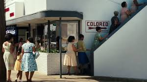 'Jim Crow' entrance for colored people to the neighborhood movie theater (circa 1960)