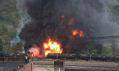 burning railroad oil tank cars at Lynchburg, Virginia 30 April 2014 (note man on roof, lower left)
