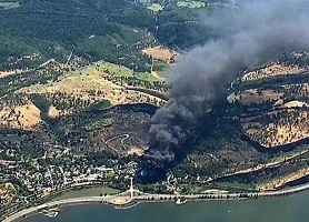 KGW-TV helicopter shot of smoke rising from the Union Pacific Railroad train derailment near Mosier, Oregon in June 2016